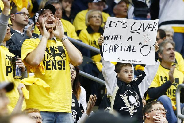 A Pittsburgh Penguins fan holds up a sign in the second period against the Washington Capitals during game six of the second round of the Stanley Cup Playoffs at Consol Energy Center in Pittsburgh, Pennsylvania on May 10, 2016. (Photo by Jared Wickerham / DKPS)