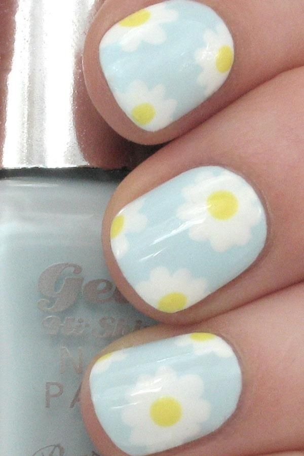 ~~Plant a bouquet of sweet daisies on your nails with this easy nail art. - DivineCaroline.com~~