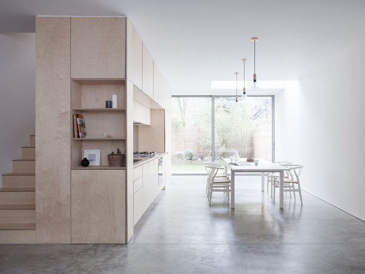 Larissa Johnston Architects transformed a crumbling Victorian townhouse into a model of clean-lined, open-plan design featuring a birch plywood kitchen and stairs.
