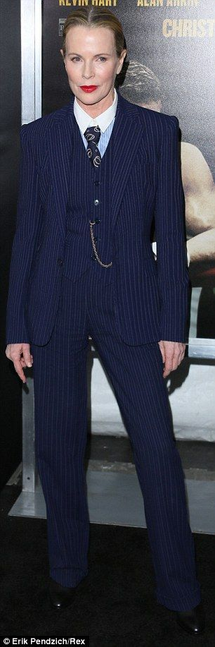mobster fashion: form-fit three piece pin stripped suit accessorised with waistcoat gold chain, graphic black tie, pale blue shirt with white collar ... worn by Kim Basinger