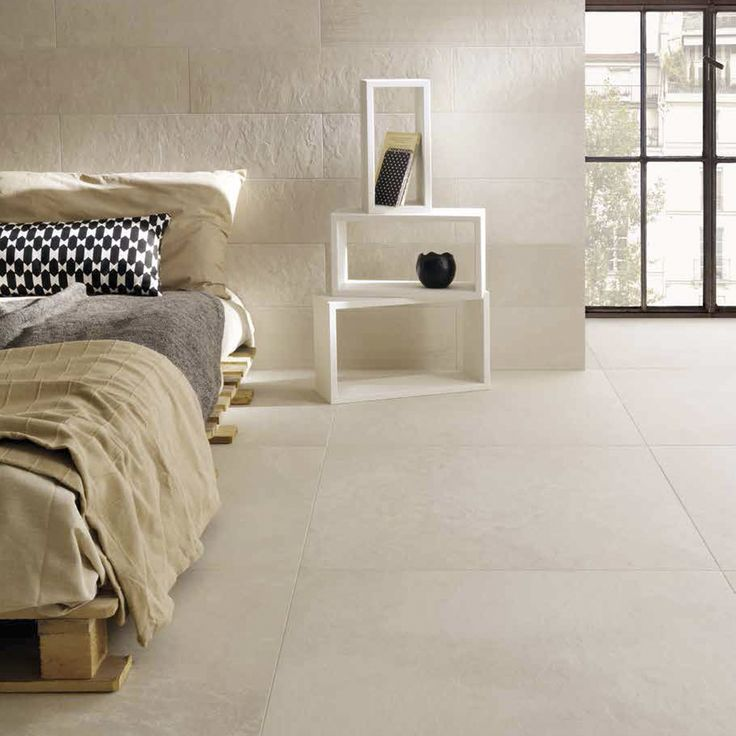Modern bedroom design with Ardesia Mix Base Avorio tile from Coem Ceramiche.