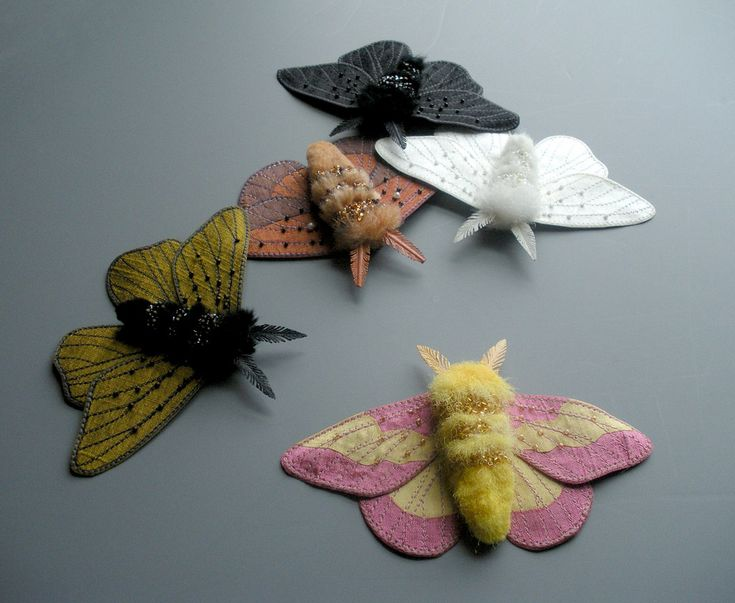 Textile moths | Embroidered moths- Rosy Maple Moth, fantasy moth in gold, Oakworm Moth, Peppered Moth (white), peppered Moth (black).