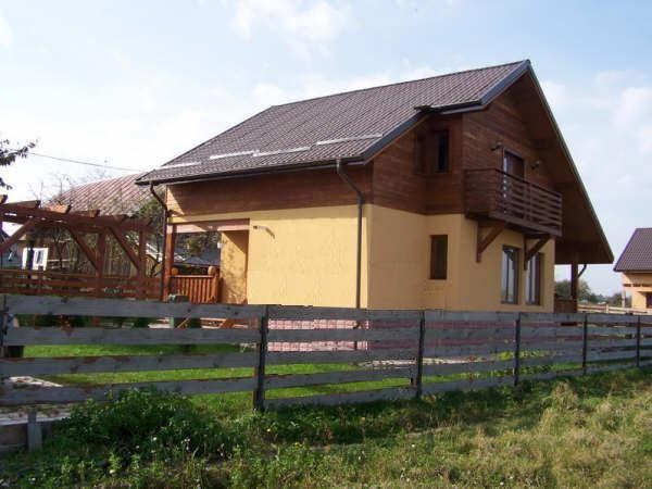 Casa de entramado de madera o de madera machihembrada (difícil decisión).