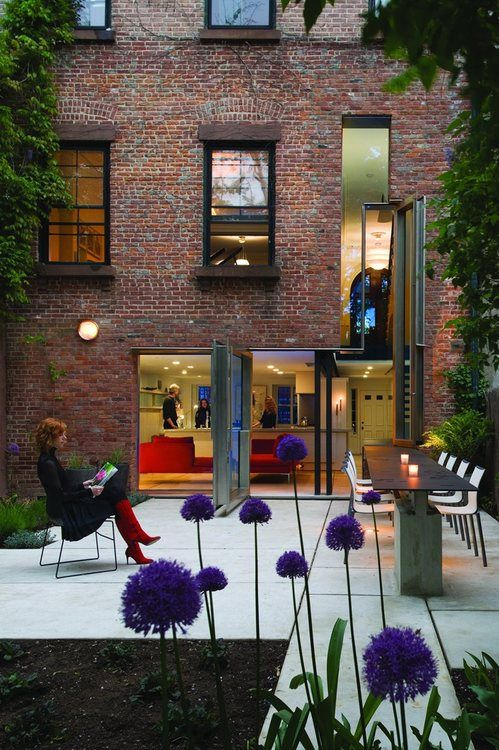 Operable Boundary by Dean Wolf Architects updates the spaces of...