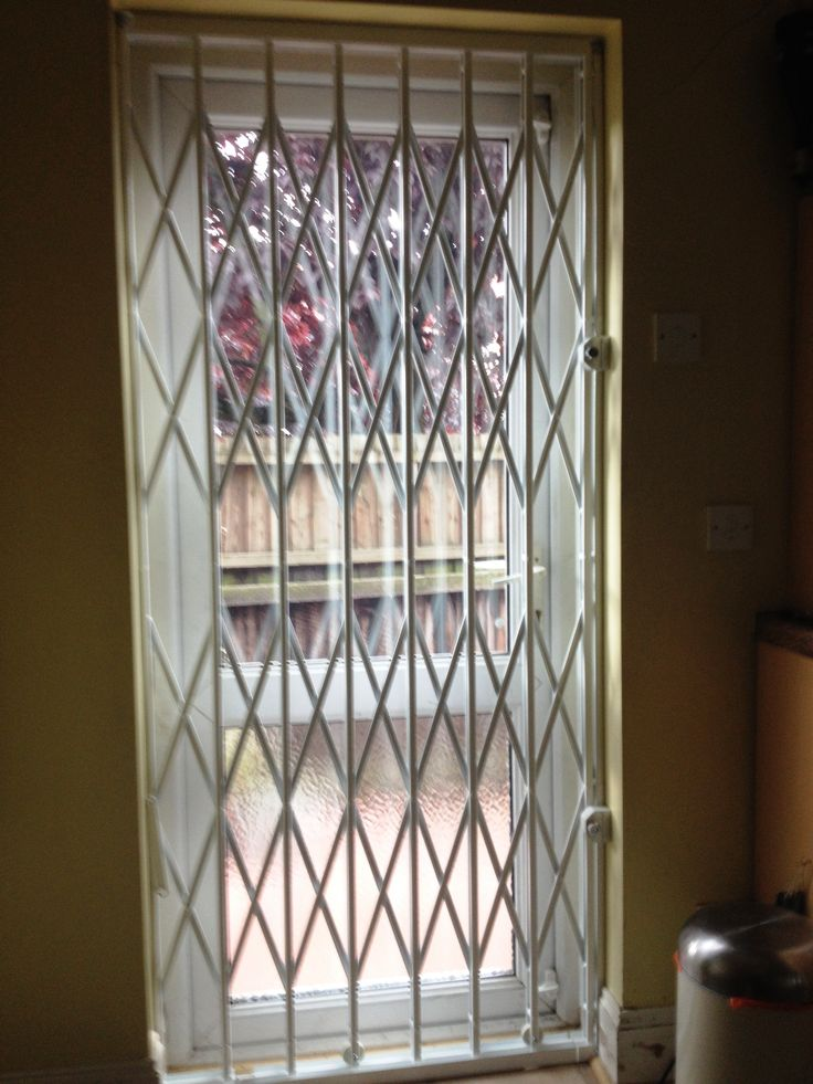 RSG1000 Retractable Security Grills fitted internally to the door of a ground residential flat in Hounslow