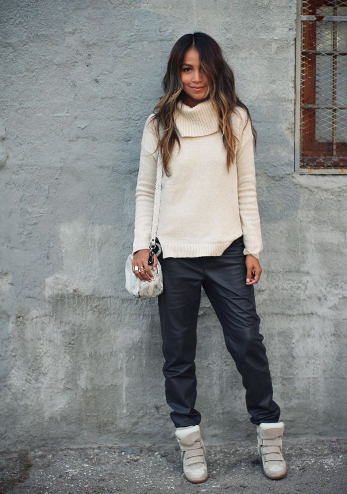 Julie Sarinana wears a cozy knit sweater with leather track pants and Isabel Marant sneakers // #Fashion #StreetStyle