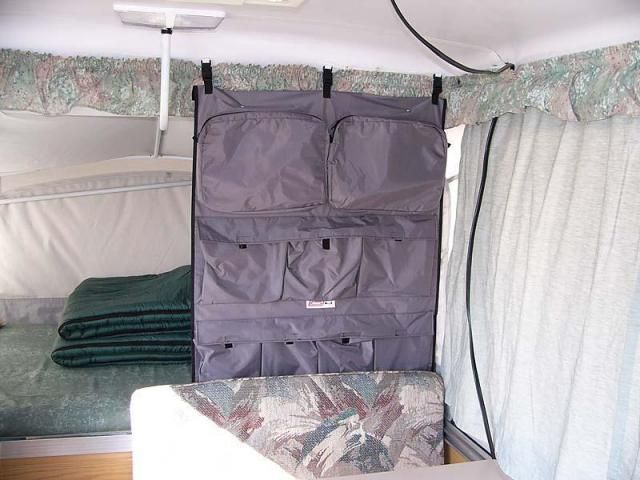 Photo: Our Fleetwood Camper Caddie hangs between the rear bed and dinette, suspended by three plastic clips secured to the ceiling, hides the clothing rod I have hanging over the rear bed, and adds a bit more privacy to that area. It has nine pockets that are handy for storing just about anything, from clothes to shoes, and easily stores flat, rolled, or folded.