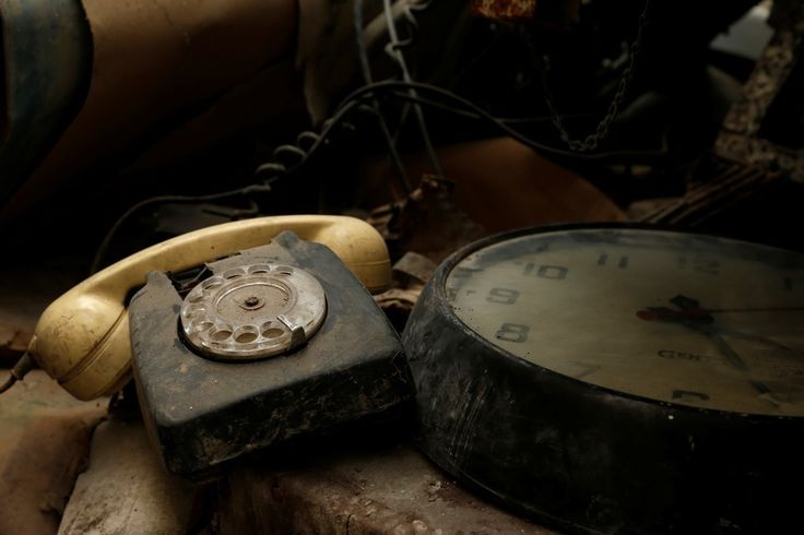 A rotary telephone and clock are seen in the NATO tunnels dating back to the Cold Warbeneath Valletta, Malta, in 2017.