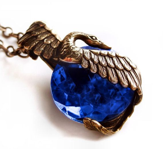 Swan necklace with rare cobalt blue antique glass jewel - would match the cuff with some antiquing.