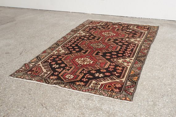 name: LADAN style: hand knotted, Persian, rug, carpet material: wool color: red, pink, raspberry, peach, gray, brown, black, cream, mint age: vintage condition: good, age related wear - see pictures  42 x 66 (closest standard rug size is 3.5x5.5)   Please see pictures for detailed condition. There are more photos of this product available on our website HomesteadSeattle.com  We ship nationwide. Please contact us if youd like a more exact or combined shipping quote.