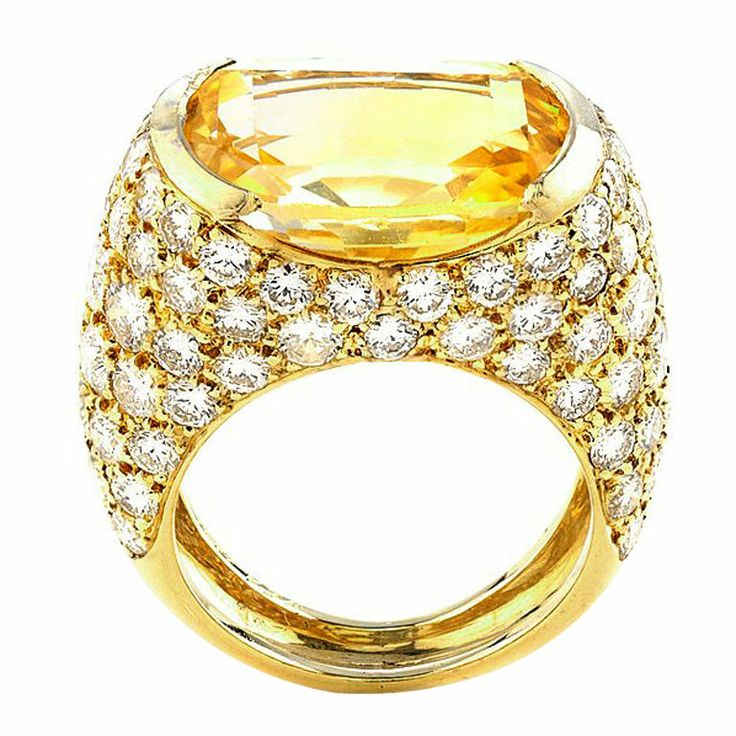 VAN CLEEF & ARPELS Yellow Sapphire Diamond Ring Specifications  Metal: 18K Gold  Stone: Sapphire  Materials/Techniques: Gold 7.80 dwt., 4.00ct. TW.    Yellow sapphire: 10.60 CT., 16.40 x 12.38 x 7.05mm.     No indications of heating.  Creator: Van Cleef & Arpels