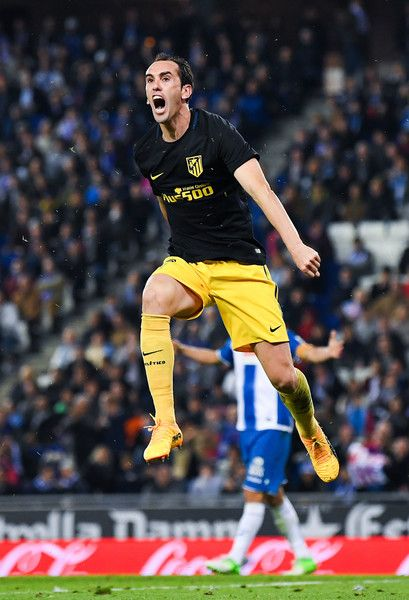 Diego Godin of Club Atletico de Madrid celebrates after his team mate Antoine Griezmann of Club Atletico de Madrid scored the opening goal during the La Liga match between RCD Espanyol and Club Atletico de Madrid at the Cornella - El Prat stadium on April 22, 2017 in Barcelona, Spain.