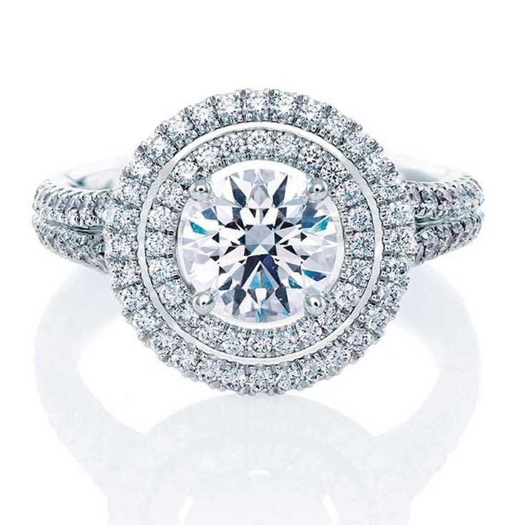 De Beers Aura Double Halo ring in platinum, set with a central round, brilliant-cut diamond and micro pavé diamonds