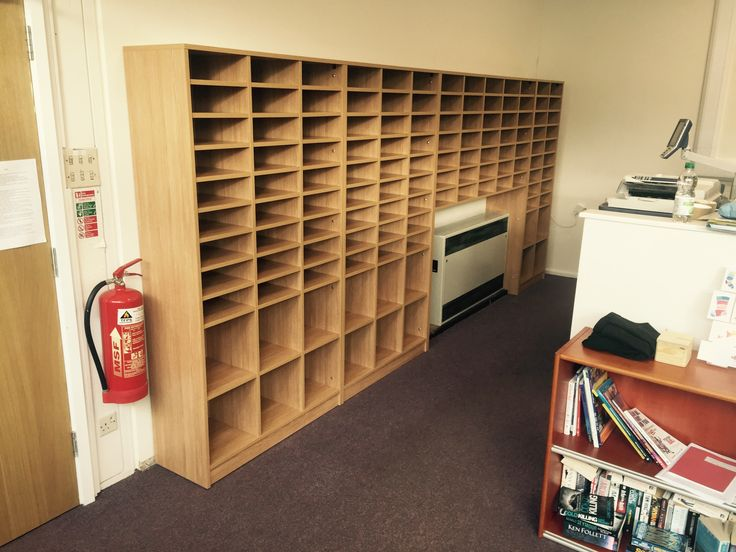 storage units for office. bespoke mixed pigeon hole and cubby storage wall installed into a school but would be units for office