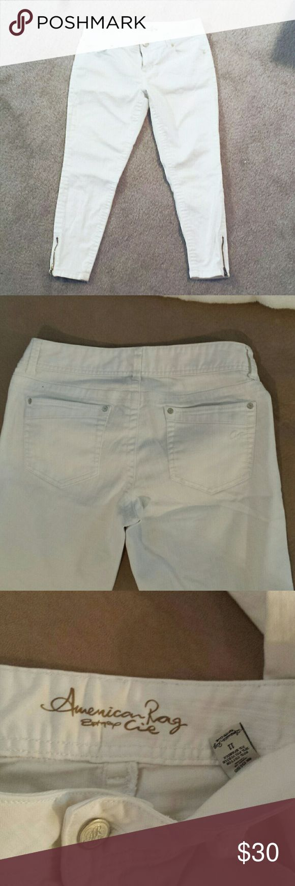 NWOT American Rag CIE White Skinny Jeans Perfect condition, just didn't fit well.  Easily dressed up or down!  Waist laying flat measures 16.5in Total Length is 35in with an inseam of 26in Ankle opening zipped is 5.5in  #NWOT #americanrag #white #jeans #whitejeans #skinny #skinnyjeans #spring #summer #fall #winter #anytime #goeswitheverything #neutral #zipper #ankle American Rag Jeans Skinny