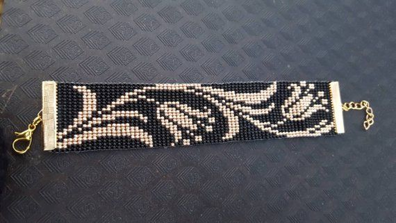Black & gold bead loom bracelet with lilys