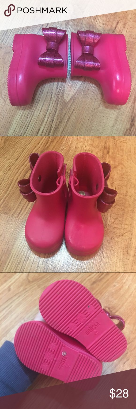 Mini Melissa Bow Rain Boots Good used condition...barely worn, but some faint dark spots on the toes. Mini Melissa Shoes
