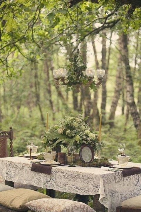 Modern Victorian woodland wedding with vintage numbers, moss and ferns and lace tablecloths - very romantic!