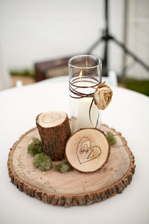 rustic enchanted forest wedding reception table centerpieces log slices carved initials moss candle twine with dried flowers