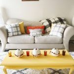 Creative Pumpkin Decorating Ideas On The Yellow Coffee Table In Autumn Living Room Design