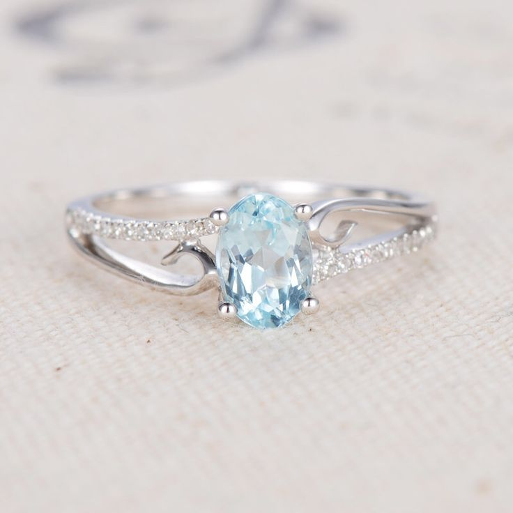 Unique Engagement Ring Oval Cut Aquamarine Engagement Ring White Gold March Birthstone Ring Micro Pave Diamond Ring Anniversary Promise Ring by LoveRingsDesign on Etsy https://www.etsy.com/listing/510801455/unique-engagement-ring-oval-cut