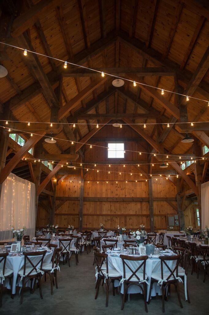 Rustic and Rainy Wedding on Martha's Vineyard- barn reception decor and design idea- string lights