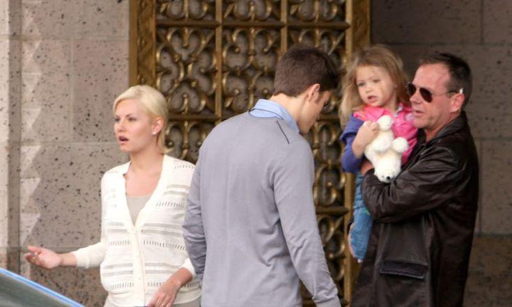 Jack Bauer carrying his granddaughter, Terri, to his daughter Kim's car.