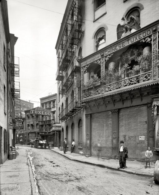 "AMAZING PHOTO: Circa 1901, continuing our tour of New York. ""Doyers Street, Chinatown."" A wholesome neighborhood where milk can be purchased ""by the glass."" 8x10 inch dry plate glass negative, Detroit Publishing Company. When viewed in full size it's even better."