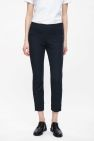 COS image 2 of Slim-fit trousers with ankle zip in Navy