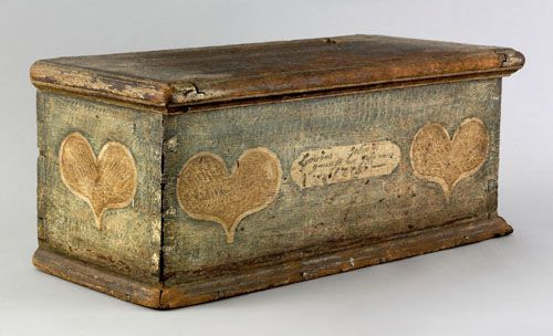 "Pennsylvania painted poplar miniature blanket chest dated 1775, probably Lehigh County, Pennsylvania, the ends and front with ivory hearts, hearts on the front center a cartouche with date and indistinct inscription, all on a green sponge ground, 8"" h., 18"" w."