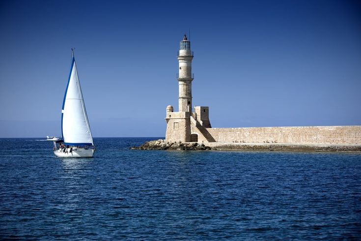 The Egyptian Lighthouse in the Venetian port of Chania - an absolute jewel of the city and the most photographed monument. #Greece #Crete #Chania #Terrabook #GreekIslands #Travel #GreeceTravel #GreecePhotografy #GreekPhotos #Traveling #Travelling #Holiday #Summer
