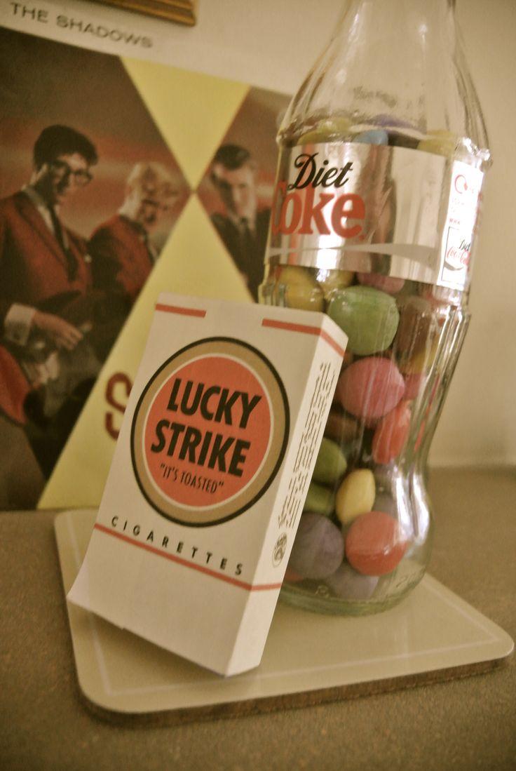 Coke bottles filled with smarties; original sixties vinyls in background