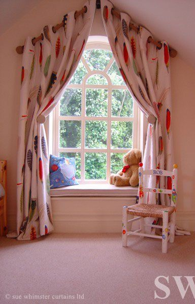 Eyelet curtains over an apex window
