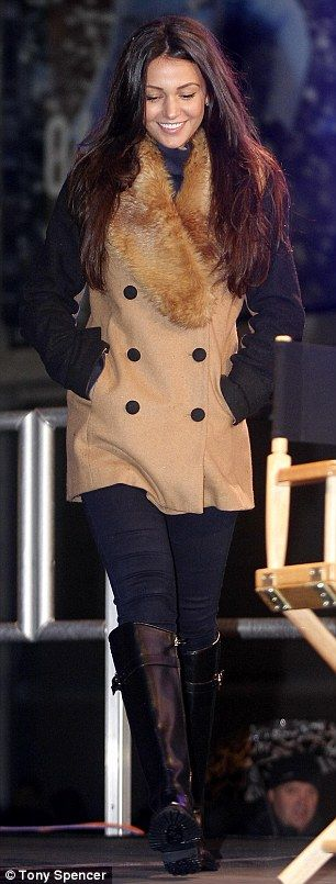 Winter warmer: Wrapping up against the chilly winter weather, the Coronation Street star looked effortlessly stylish in a black and camel double-breasted coat with a chic faux fur trim around the collar