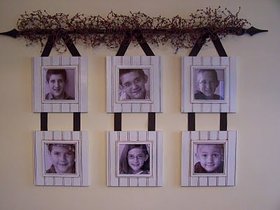 More beadboard picture frame displays (pictures are hung from a curtain road draped with berry garland).