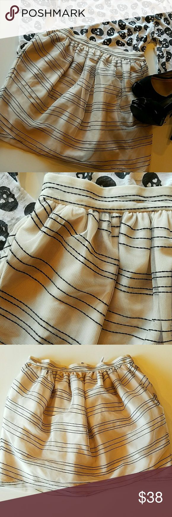 "BCBGeneration skirt Adorable tulle skirt, NEW, never worn.Black stripes on ivory color tulle, fully lined. Inseam POCKETS!  Waist 13.5"", lenght 15"" BCBGeneration Skirts"