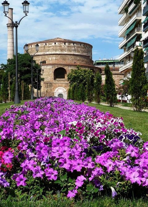 "Thessaloniki, Greece - ""Rotunda"", Roman monument.    The Rotunda was a massive circular structure with a masonry core that had an oculus like the Pantheon in Rome. It has gone through multiple periods of use and modification as a polytheist temple, a Christian basilica, a Muslim mosque, and again a Christian church (and archaeological site). A minaret is preserved from its use as a mosque, and ancient remains are exposed on its southern side."