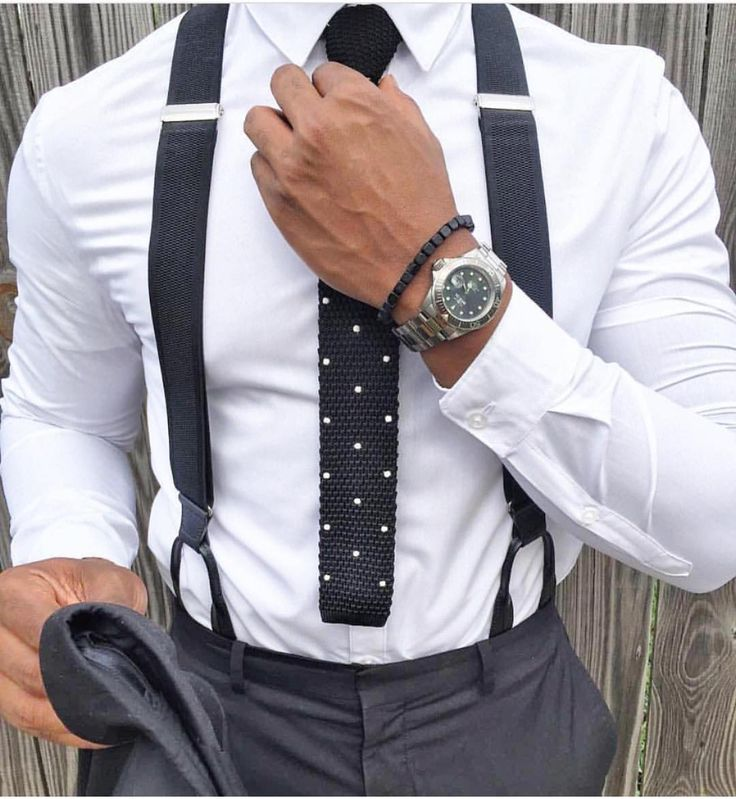black suspenders and knit tie