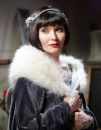 Essie Davis as Phryne Fisher in Miss Fisher's Murder Mysteries .