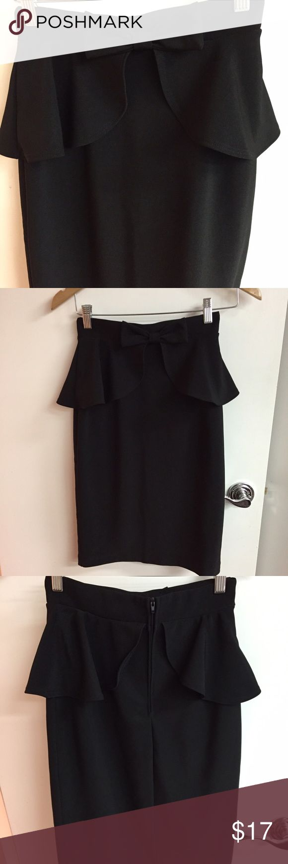 NWOT Black pencil skirt with bow detail Black pencil skirt with bow and peplum detail. Never used!!!!! Lulu's Skirts Pencil