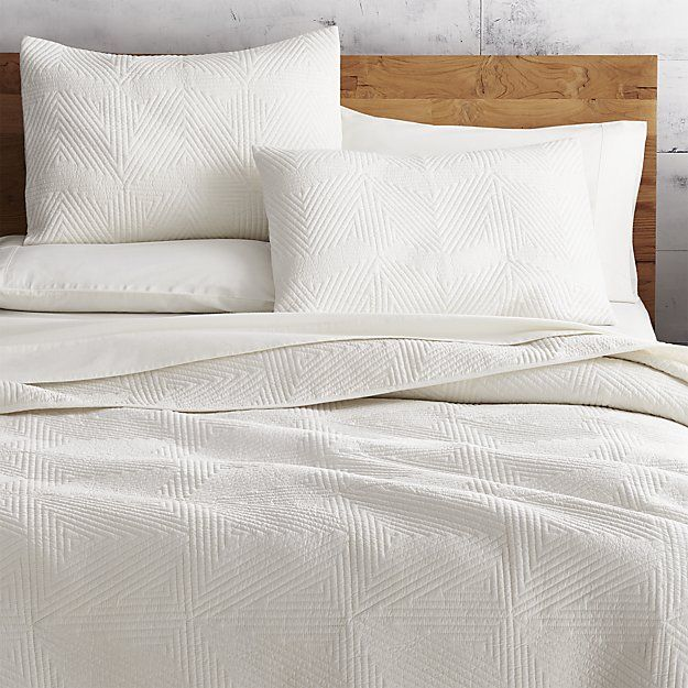 Shop Triangle Ivory Bedding.  Concentric triangles quilt a fresh texture on soft cotton. Triangle Ivory Bed Linens is a CB2 exclusive.