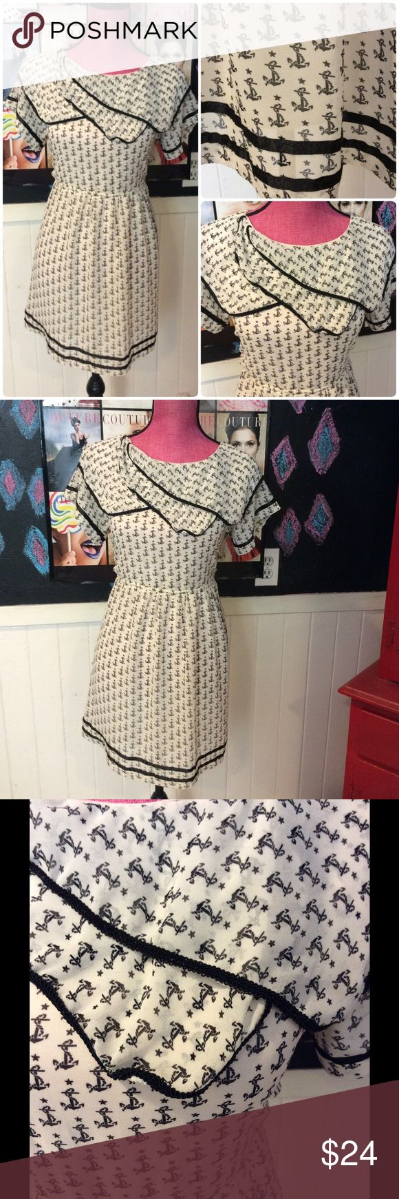 """Babydoll nautical summer dress⚓️❤️szM Nautical fun in this babydoll style anchor dress.  Black and white chest is 36"""" and waist is 34"""".  In worn once condition. Dresses"""