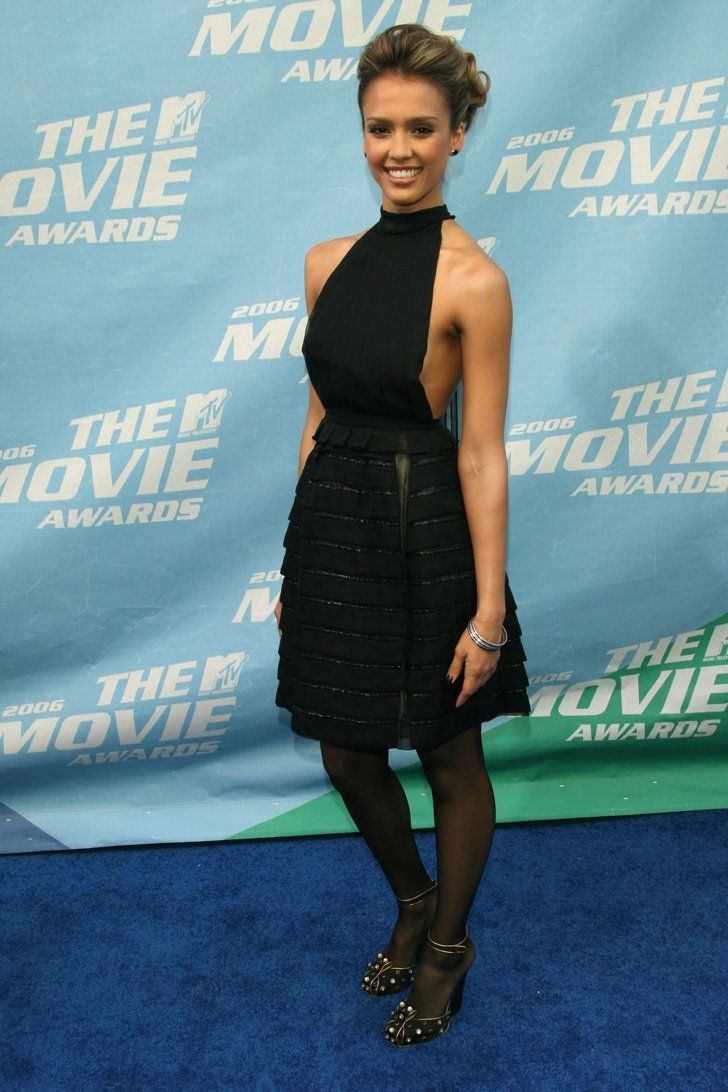 Pin for Later: #TBT: Remember When These Looks Walked the MTV Movie Awards Carpet? Jessica Alba Jessica Alba attended the 2006 show in a high-necked black dress, tights, and heels.