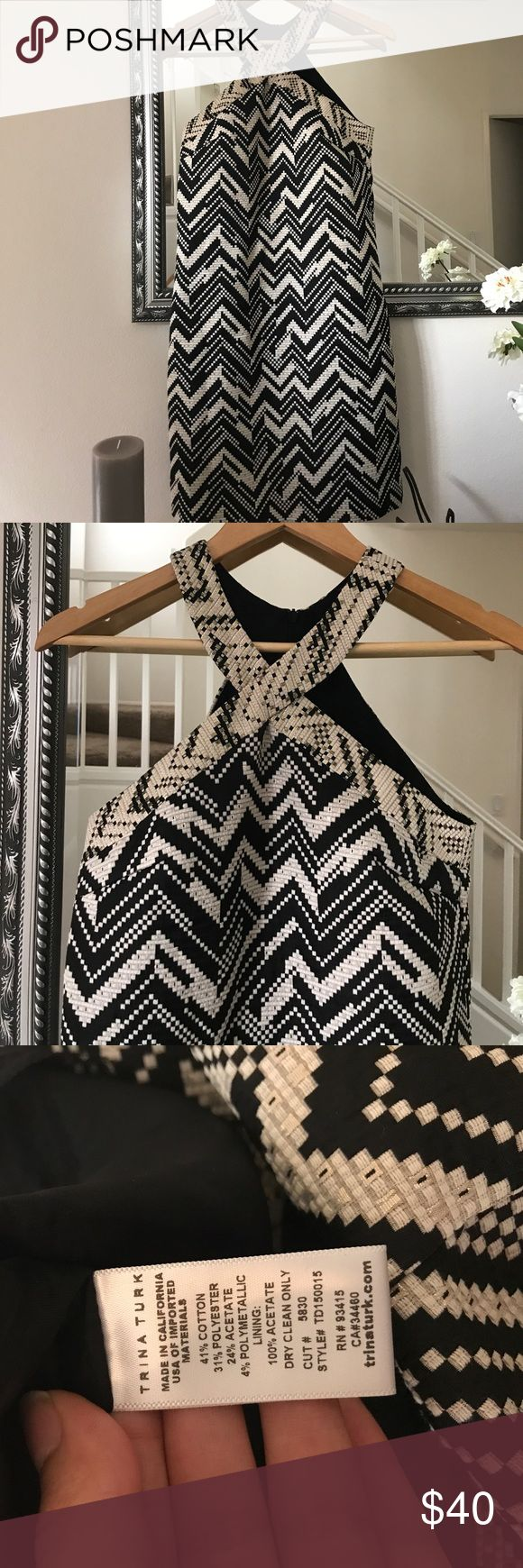 Trina Turk black/cream chevron print dress Trina Turk black/cream halter style dress; dress has hints of gold as well; dress has attached slip inside; size 2 & new/never worn; open to offers :) Trina Turk Dresses