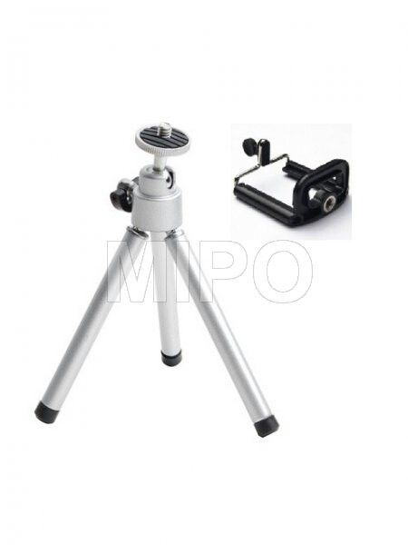 Mini Tripod Holder  Mini Adjustable Tripod + Camera Holder for Iphone and Other Smartphones  It is suitable for different kinds of cell phones,could expand up and down or left and right.  A really good partner for camera phones,makes your photography better.  Features : It is suitable for locating different size/thickness of camera phone Easy to adjust,possible to rotate in any angle, and both OK for transverse or vertical locating the camera phone Small size, easy to carry and operate A…