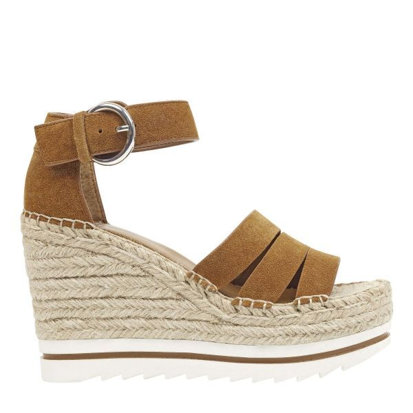3568e9e67 An espadrille wedge with a sporty bottom details the Sammy sandal in a  strappy silhouette complete with an adjustable ankle strap.