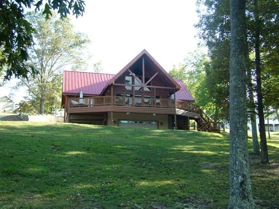 This custom built Log home on year round water has it all beautiful water views open floor plan stone fireplace (woodburning) tile flooring master suite with private deck 2 additional bedrooms each with their own private baths expansive decks and patios 2 boat slip dock and concrete boat ramp. All this on a level waterfront lot. Call today to schedule a tour of this property