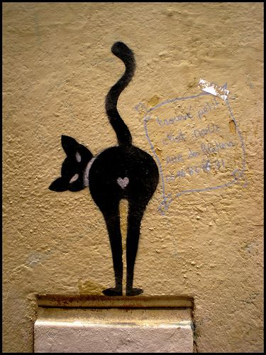"""Grandpa used to draw this in stages and asked us kids to quess what it was. The answer-""""North end of a south bound cat"""""""