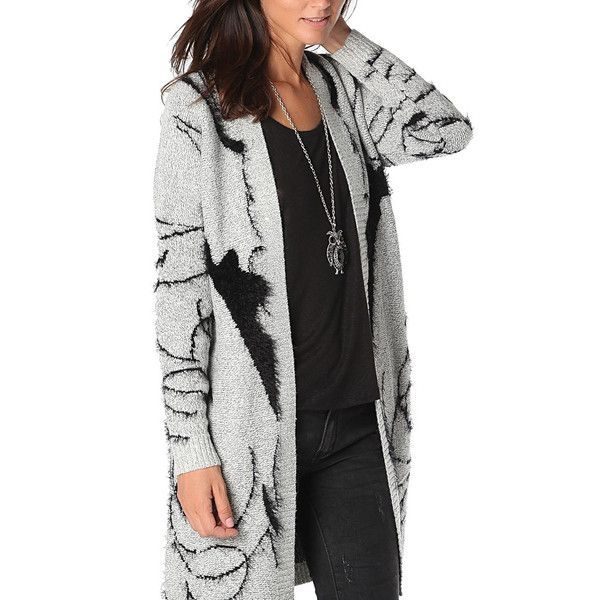 Printed oversize cardigan in mid-weight soft touch knit. Open front with ribbed trims.