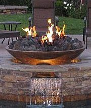 Fire pit with waterfall. Maybe it's time for 5 Pebbles to get into some outdoor furniture.